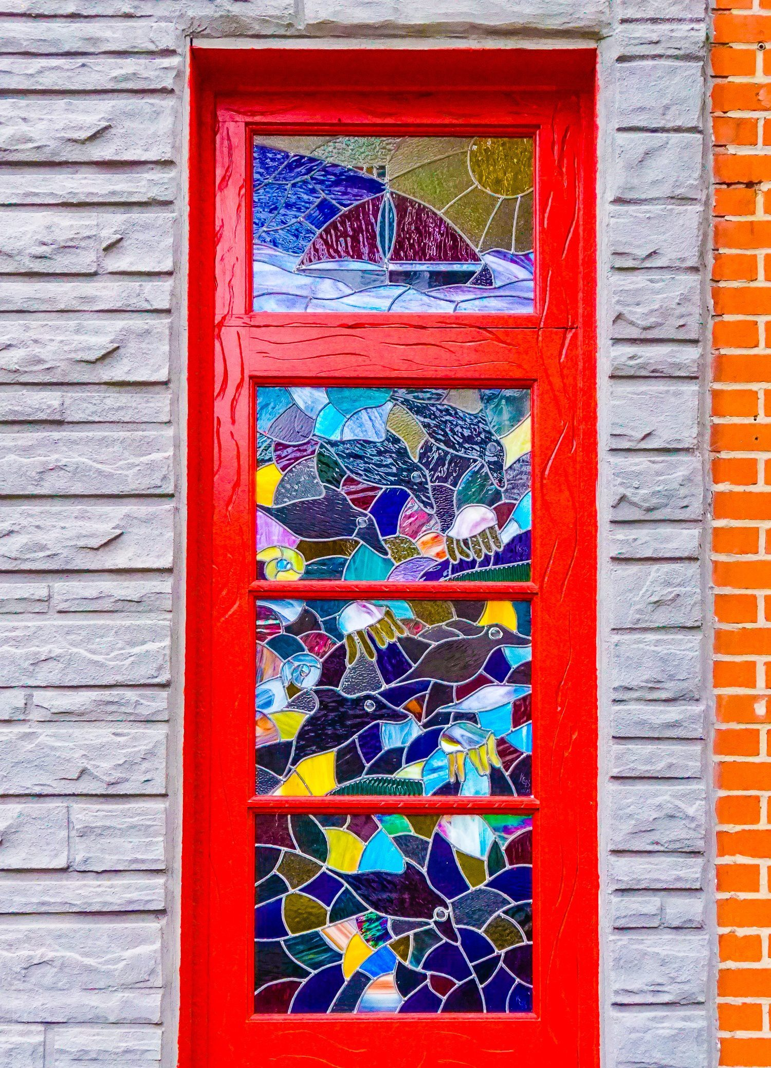 This beautiful red stained-glass door is a perfect example of why Fishtown, Philadelphia has some of the best public art in Philly!