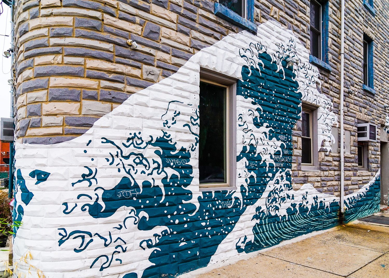 This building's wave wall echoes the watery theme.