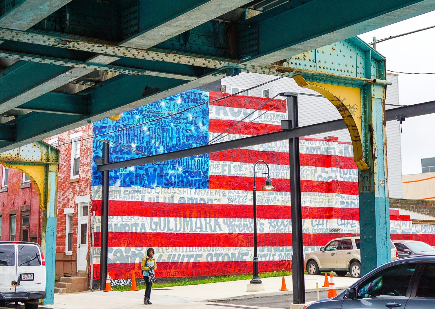 A flag mural, emblazoned with the names of local stores.