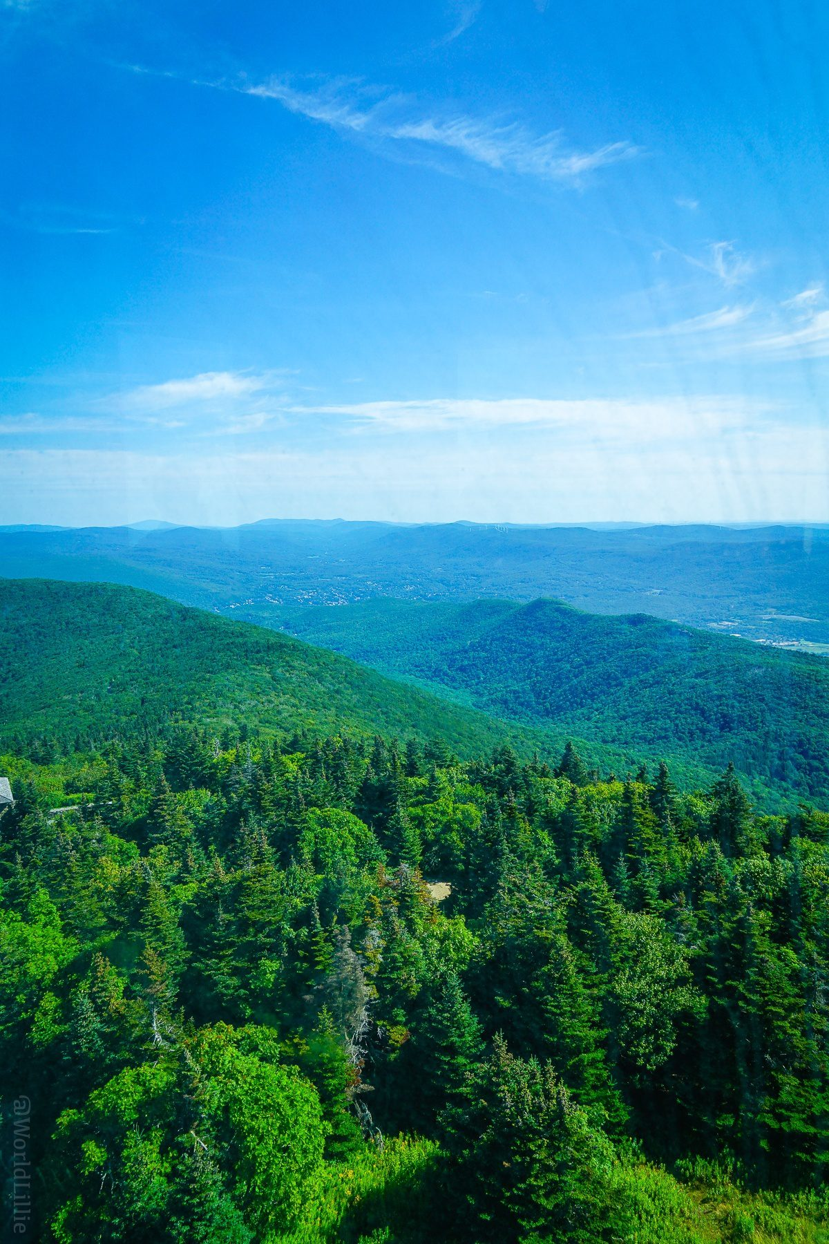 Planning travel to Mount Greylock, the highest point in Massachusetts? Here's the easiest way up the mountain to see great New England views, even with young kids. Pictured: the view from atop the Veterans War Memorial Tower.