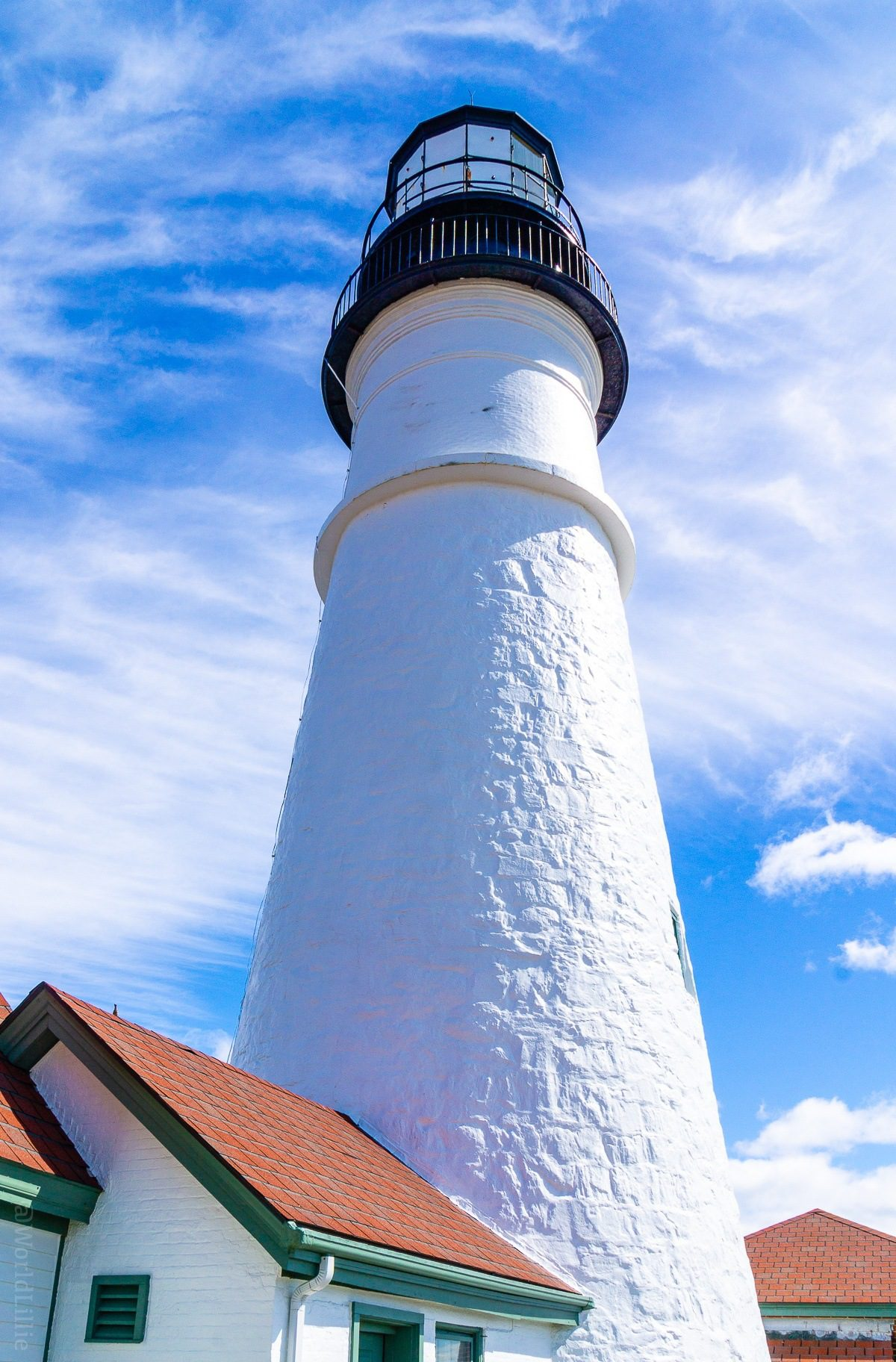 Looking up at the Portland Head Light. Portland, Maine is a perfect New England trip a short drive from Boston. Here are #travel and visiting tips on food, what to do, and what to see. #PortlandME #Maine #NewEngland