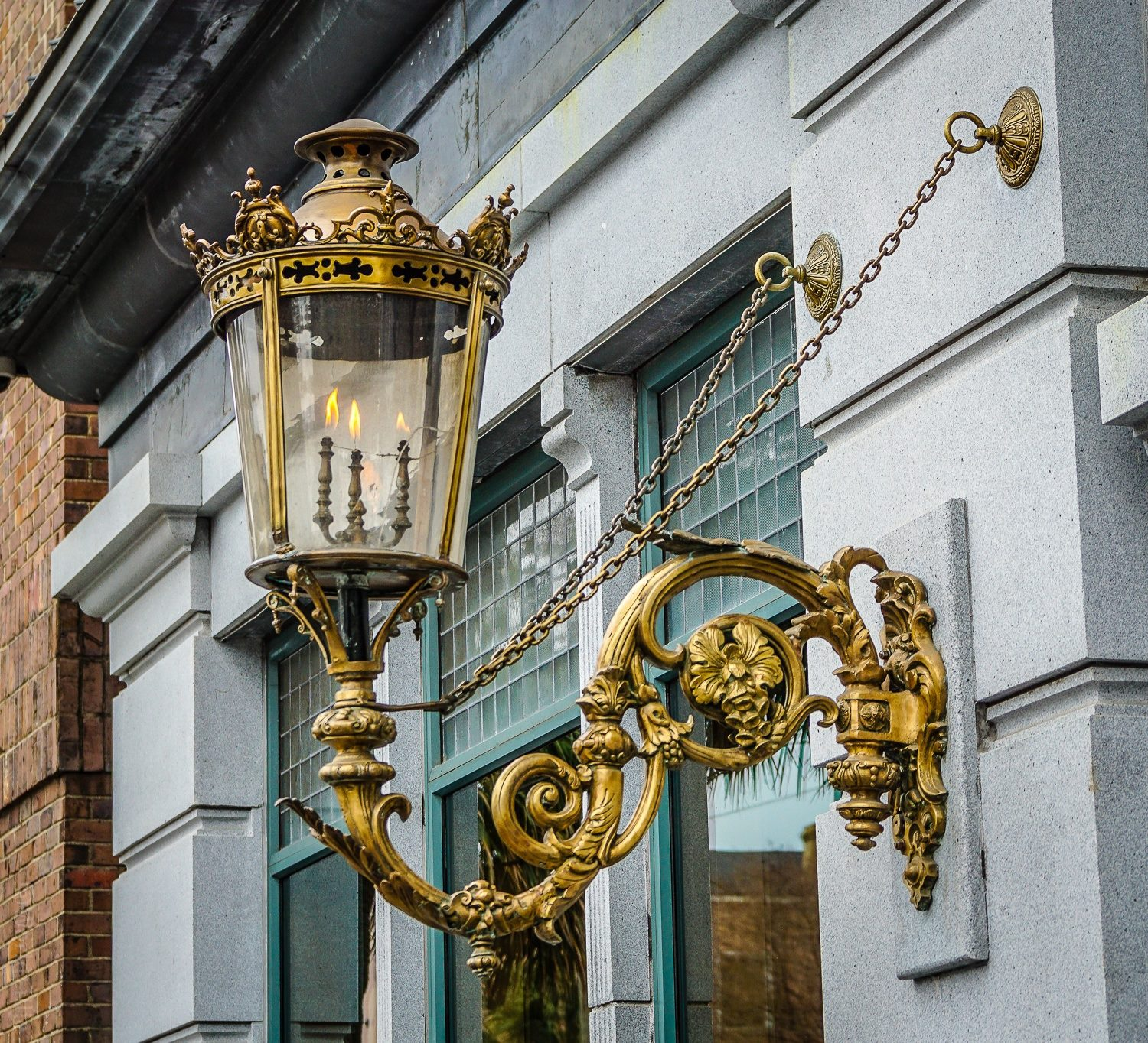 Gold and ornate lamp-holder.