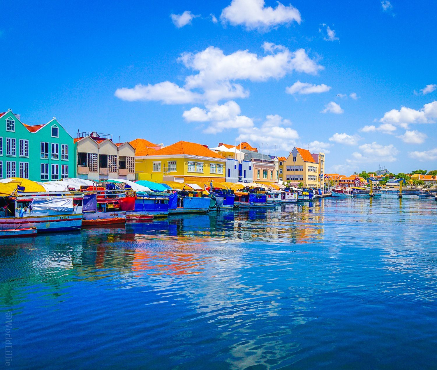 Willemstad, Curacao: Fishermen's boats reflect the water.