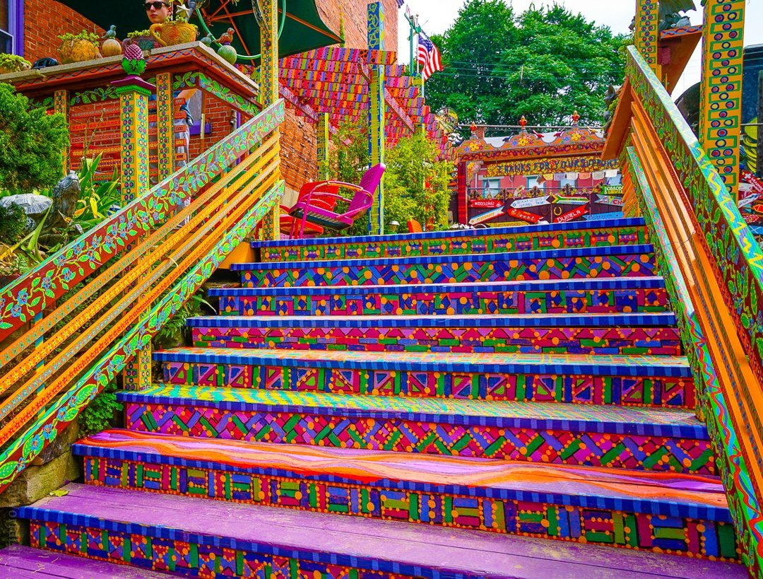 Walk with me up the psychedelic rainbow steps of Randyland.