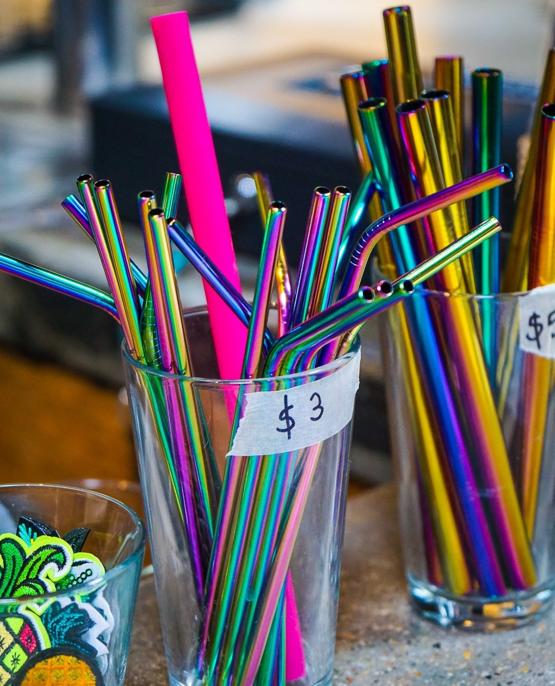 Central Square in Cambridge, MA has some of the best mural arts and local food in the Boston area, including Graffiti Alley! See tips from a tour that focuses on unique small businesses! Pictured: Rainbow metal straws at Abide.