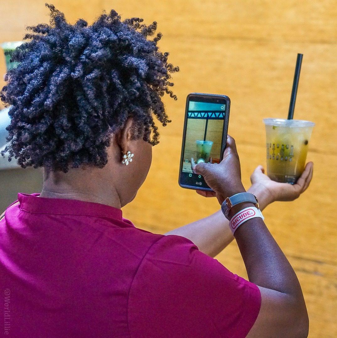 Steph instagramming her pineapple tea.