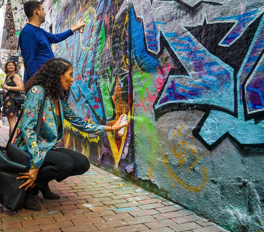 Harmonie (legally!) spray painting a peace sign!