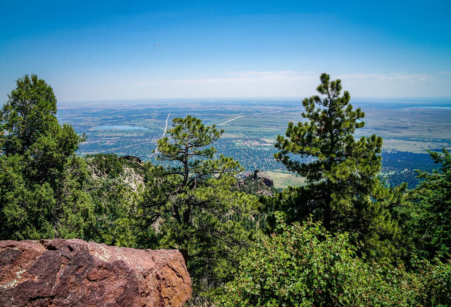 Green mountain summit view of flat Boulder, CO