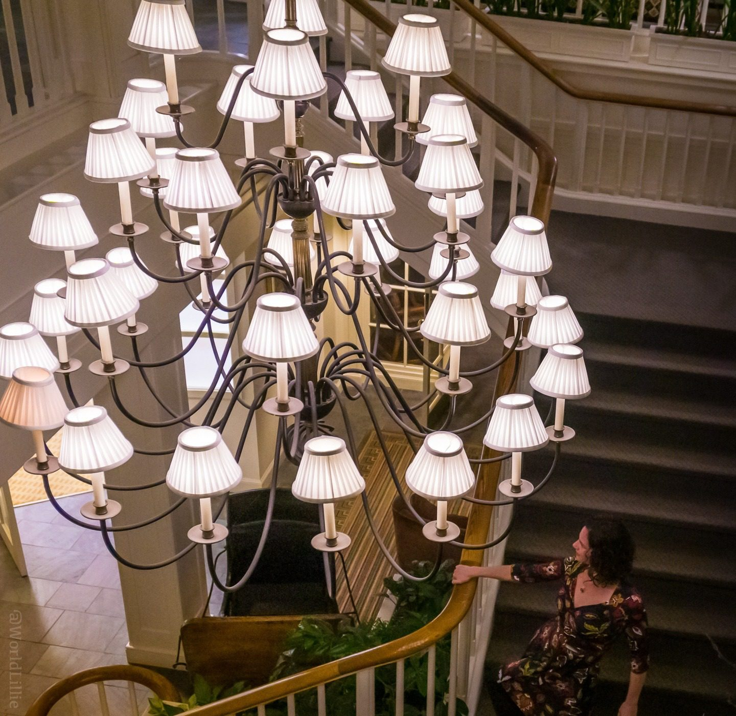 The grand chandelier and staircase of the Woodstock Inn.