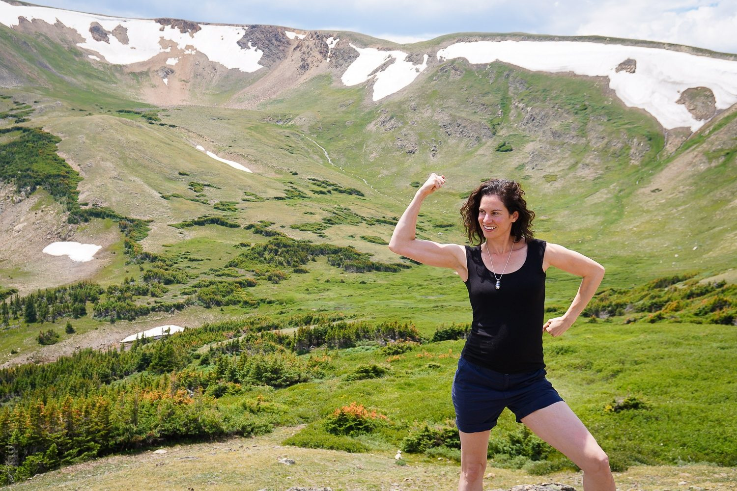 Flexing bicep muscles in Colorado Mountains: RMNP