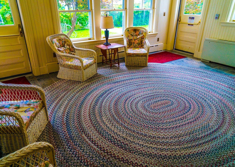 Giant circular braided coil rug in Red Lion Inn entryway, Stockbridge, Massachusetts.