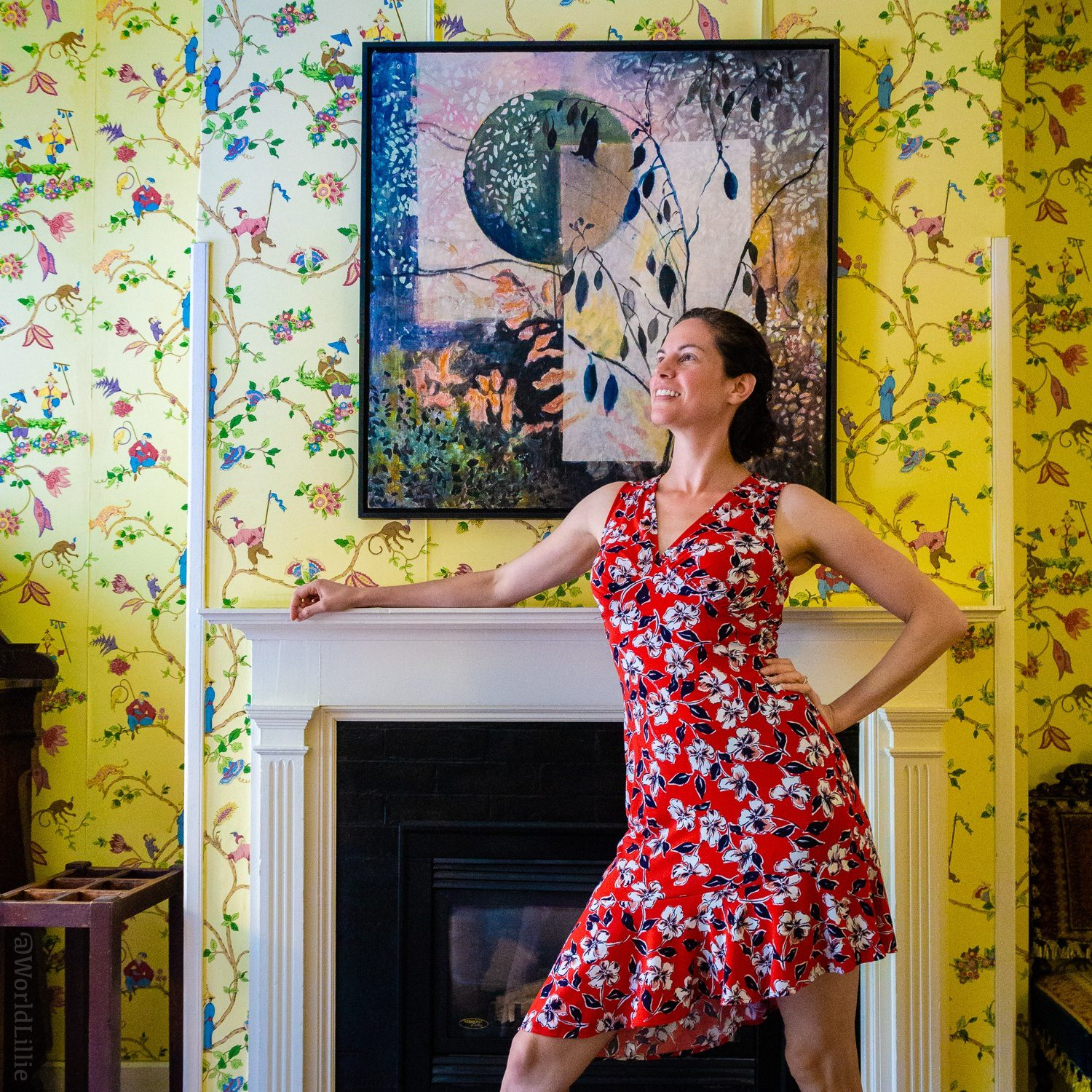 Red Lion Inn Stockbridge yellow patterned wallpaper in the Stagecoach room, contrasted with a patterned travel dress.