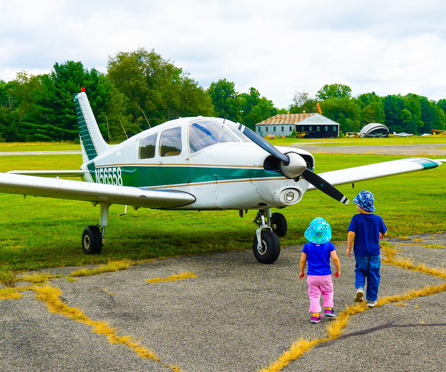 Little cuties investigating aviation up close.