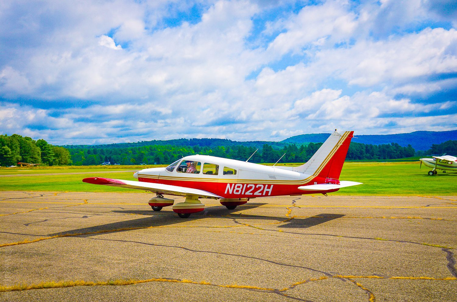 A tiny plane taking off in the Berkshires.
