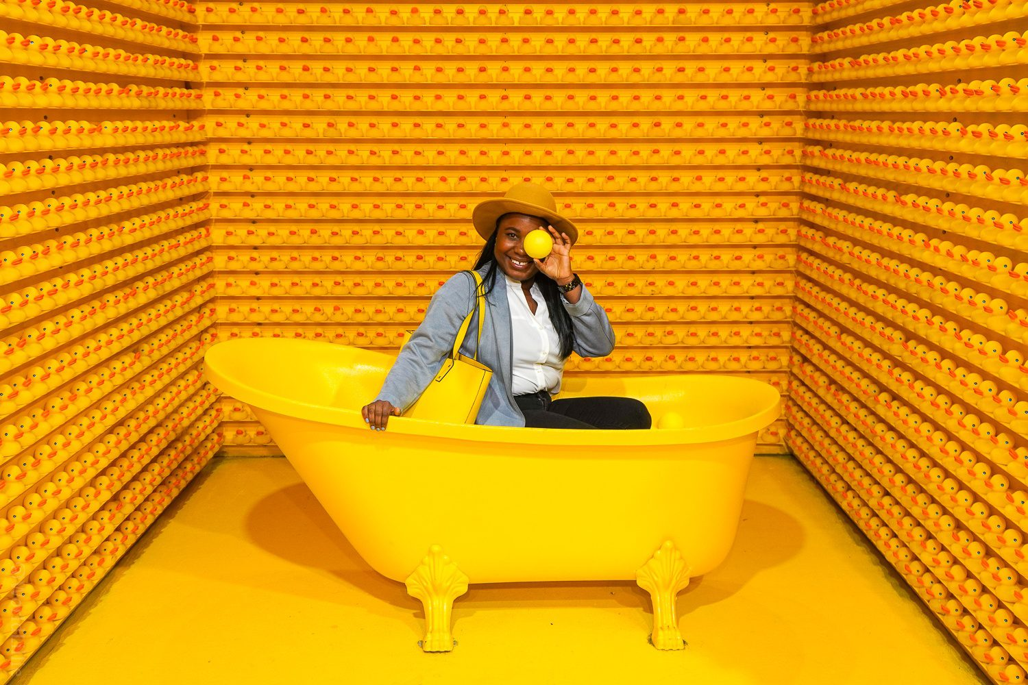 Rubber ducky walls and yellow bathtub with balls at Happy Place