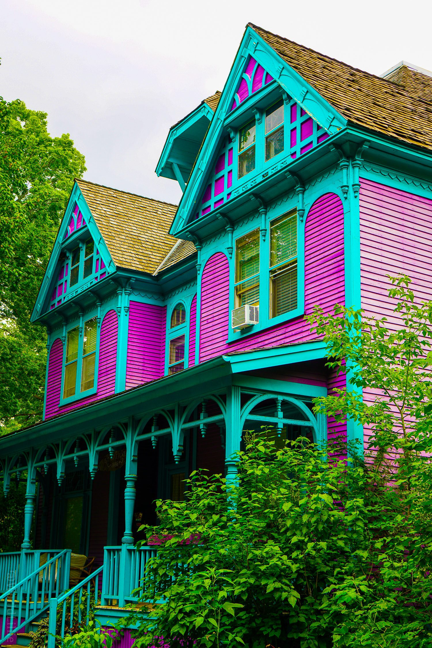 A purple and green house across the Mississippi River.