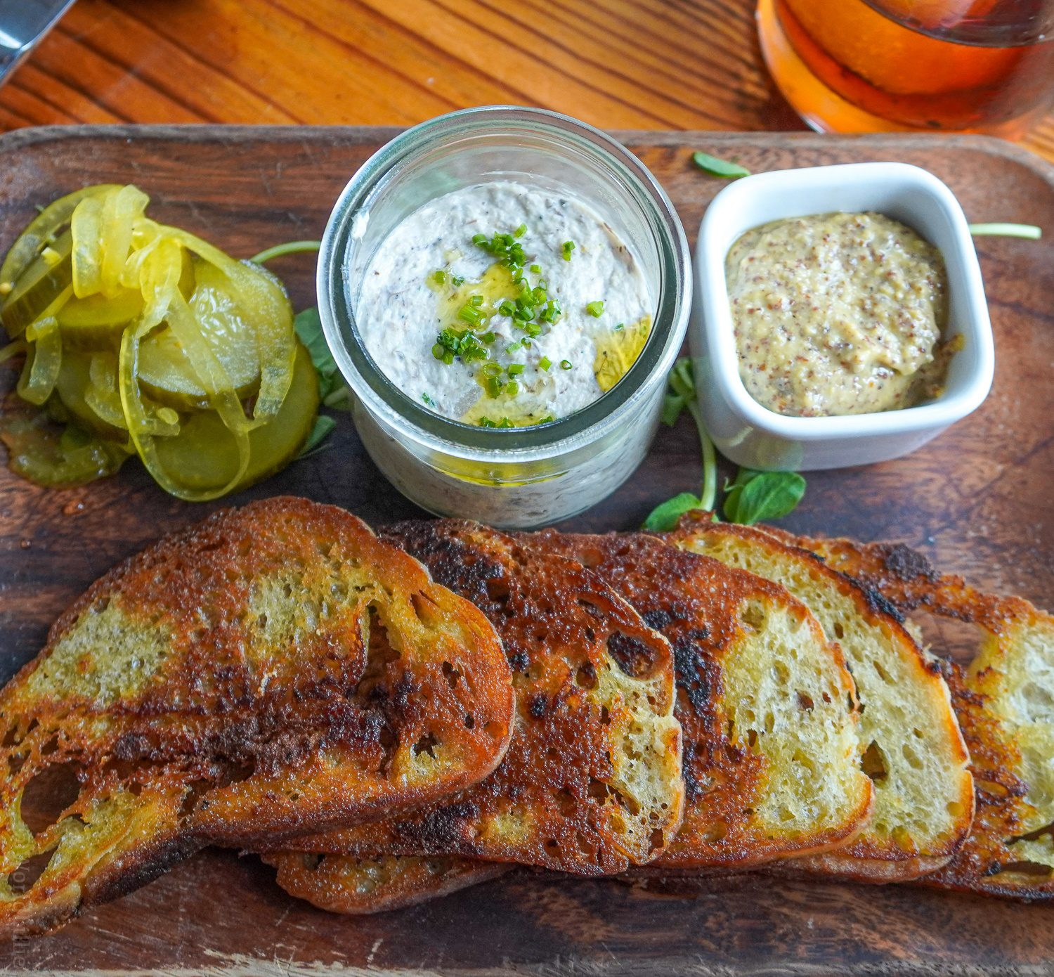 Smoked bluefish pate, mustard, pickles, and toast at Water Street.
