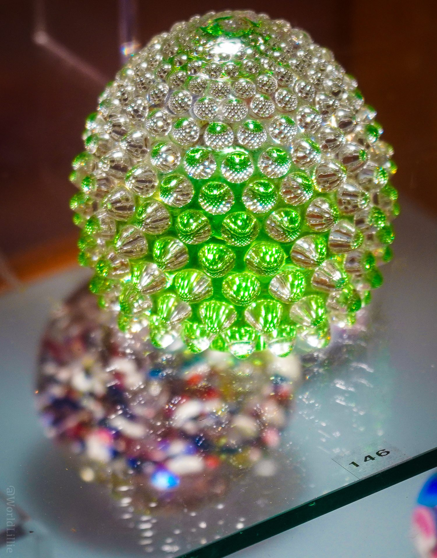 Nubbly green glass paperweight