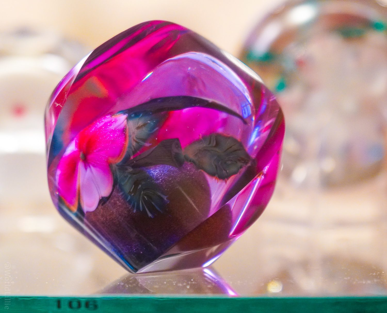 Magenta glass paperweight