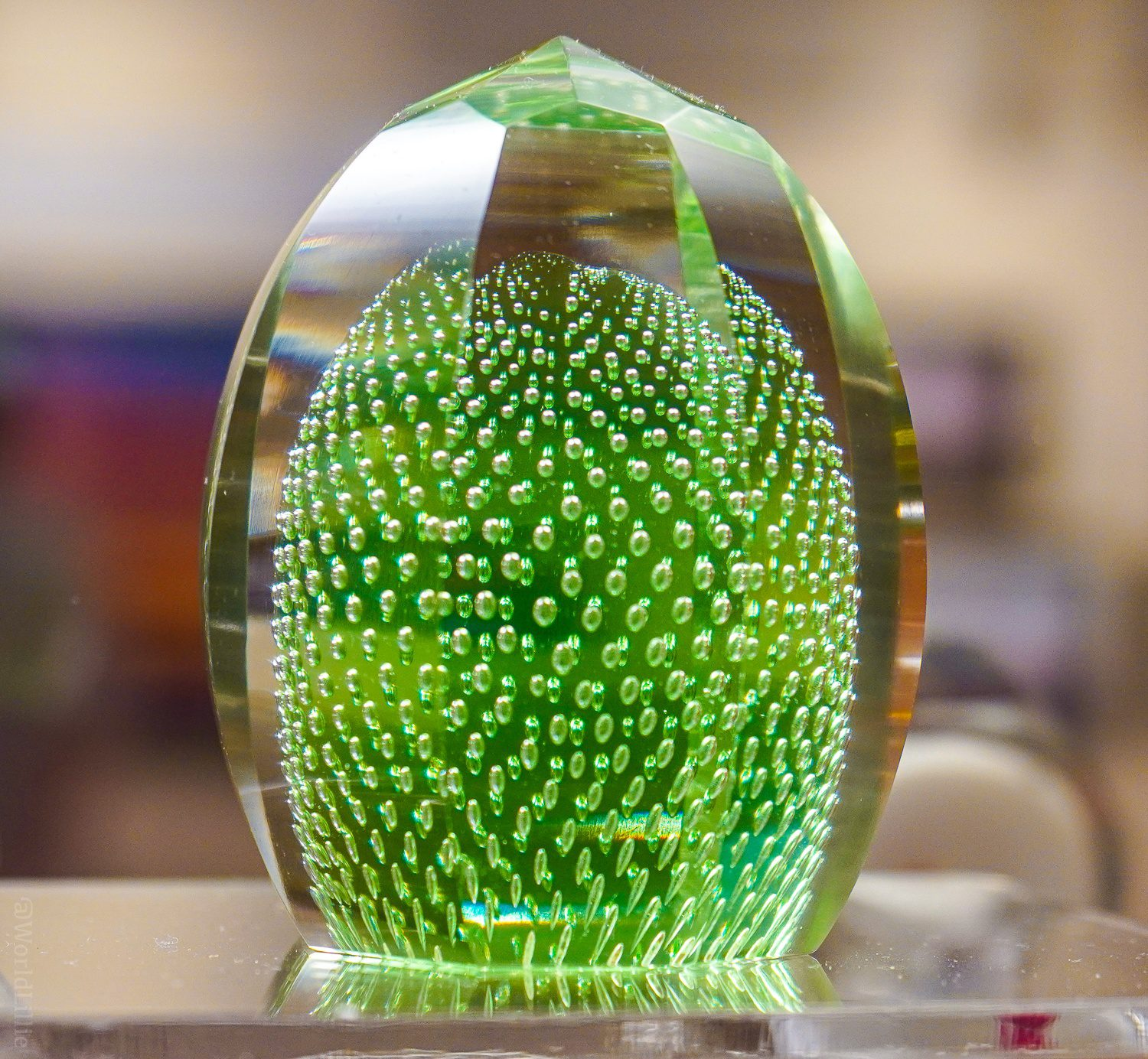Bubbly green glass paperweight