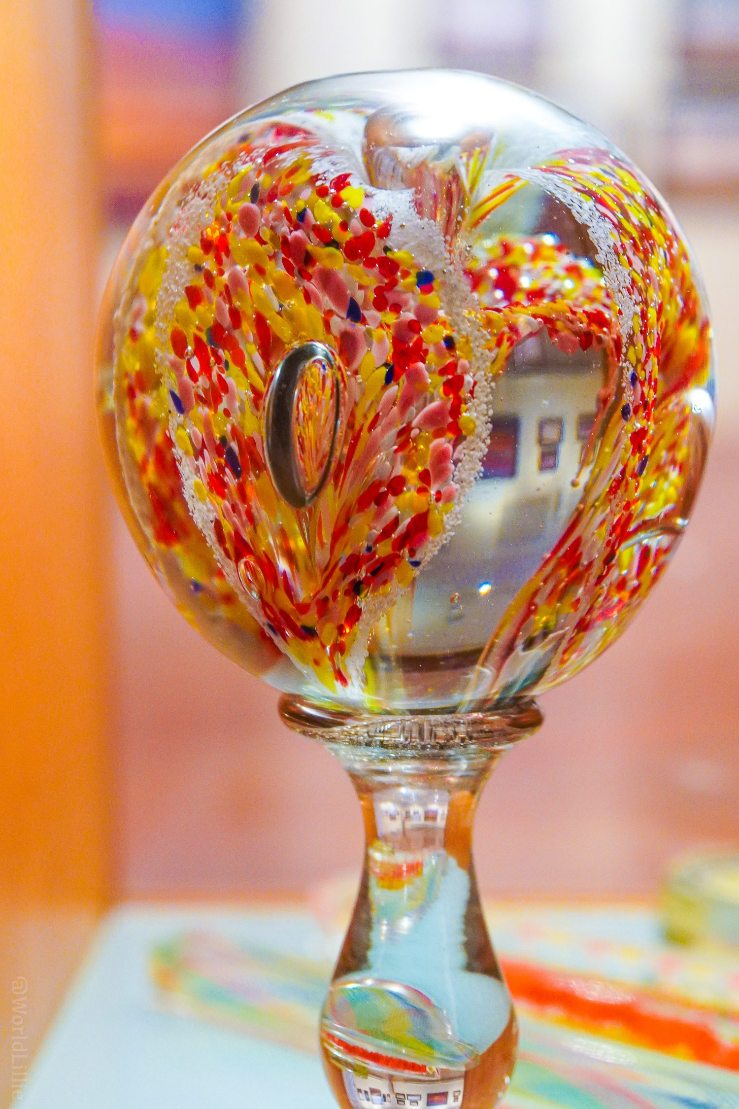 Red and yellow glass paperweight