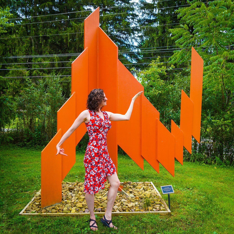 Orange sculpture matching pose