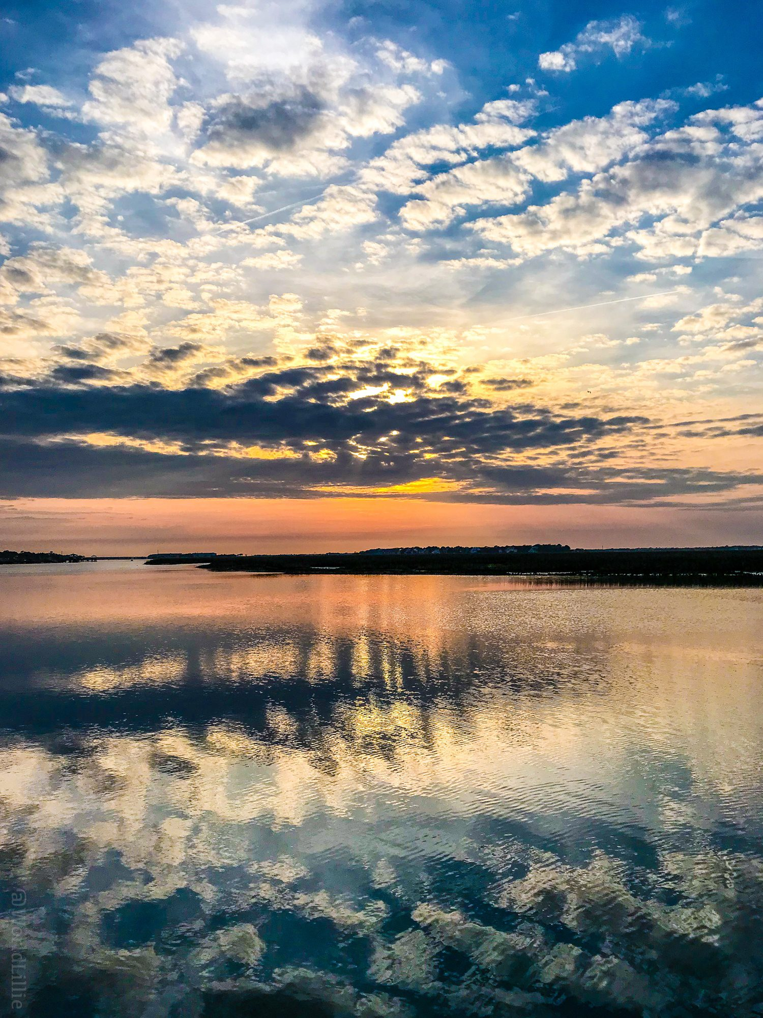 Clouds reflected on water at sunset