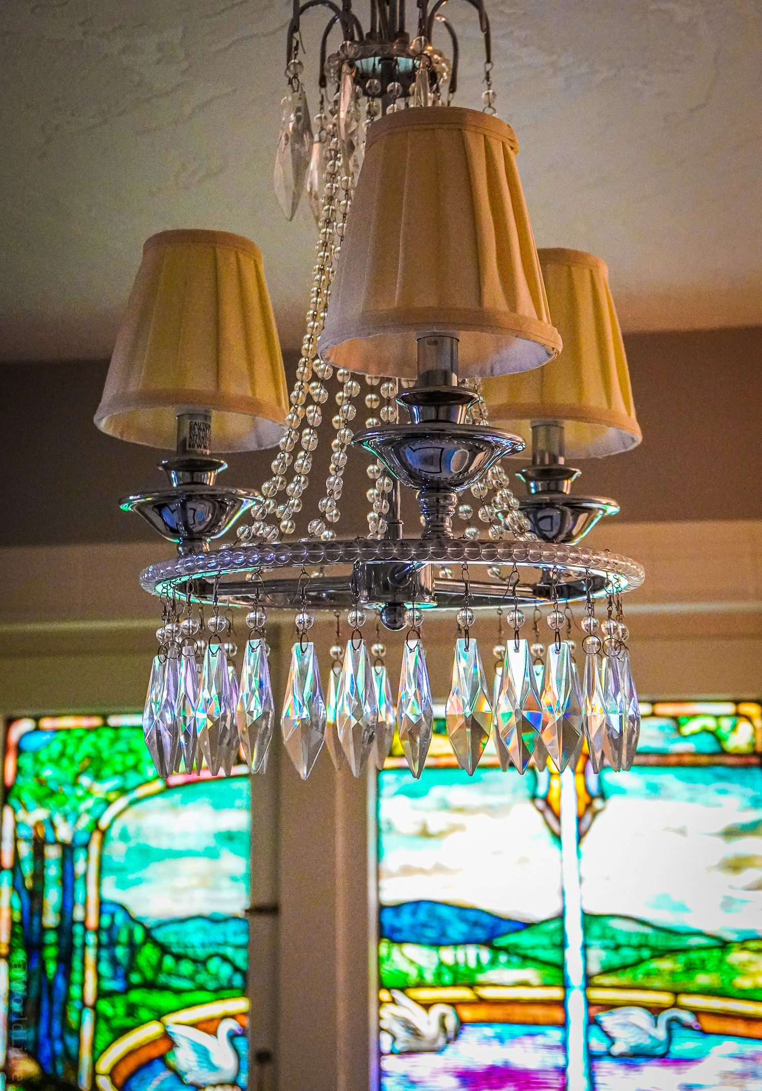 Stained glass and chandelier... in our hotel bathroom!
