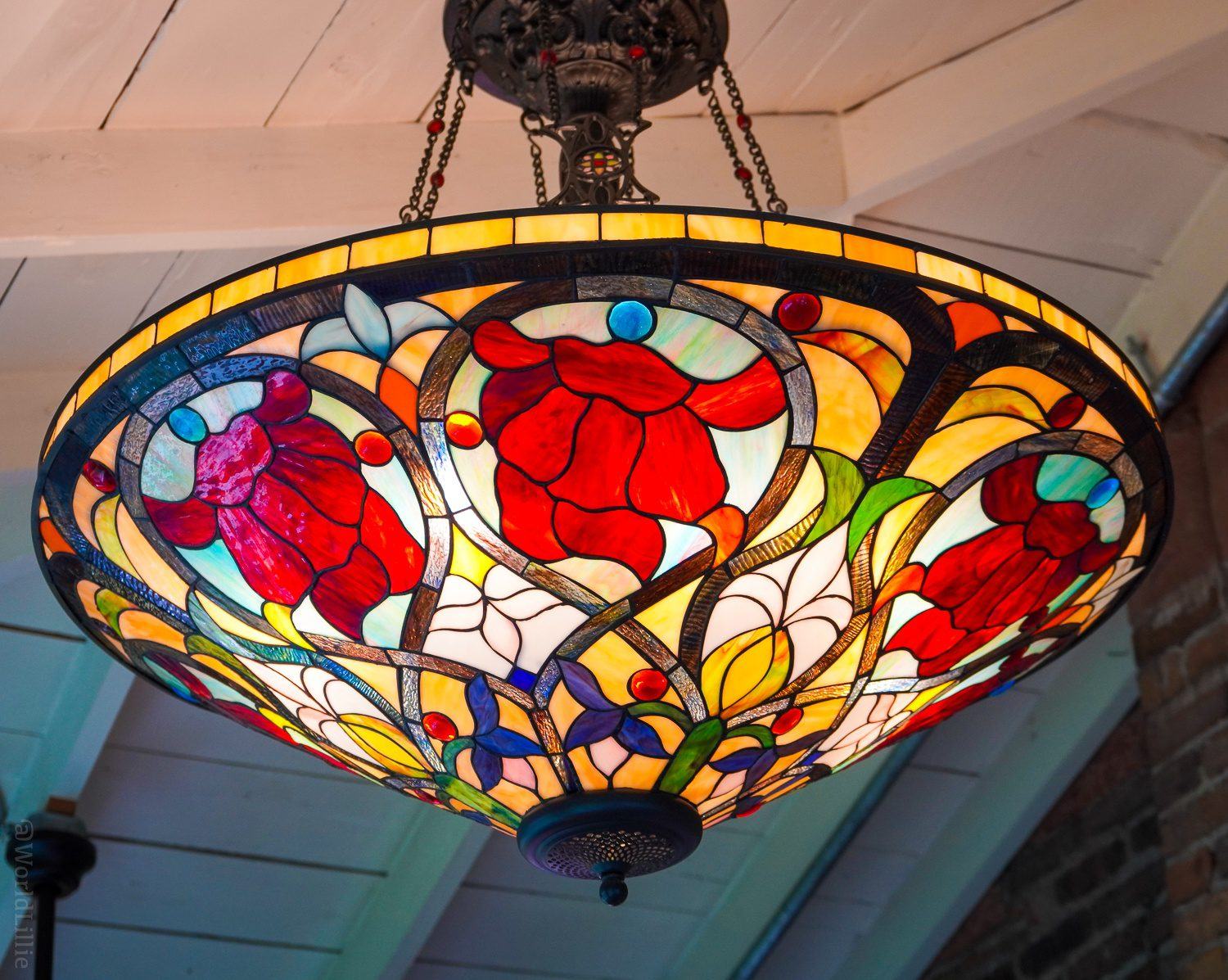 A close-up of the stained glass chandelier at Myriam's Table.