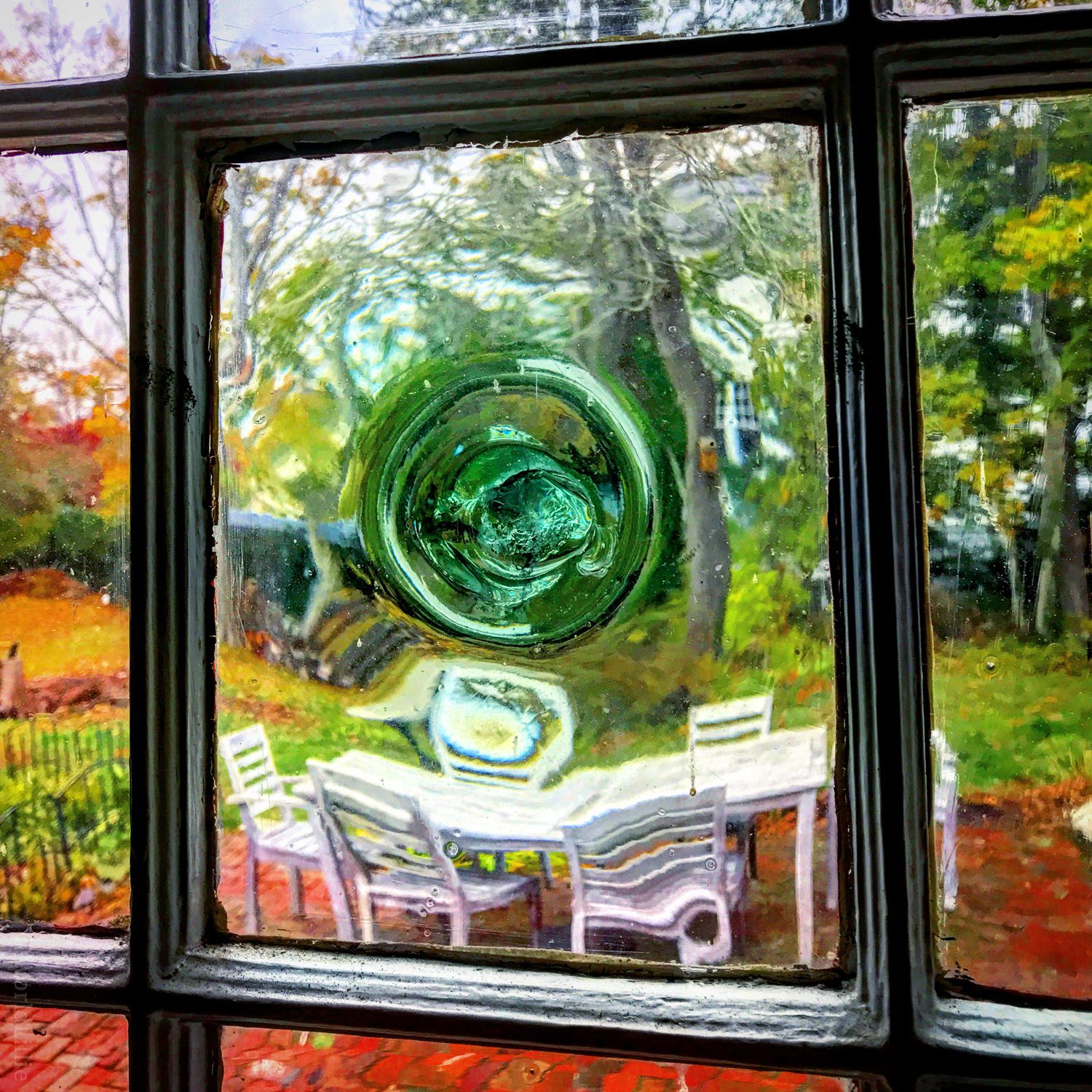 A warped window at a historic Cape Cod house.
