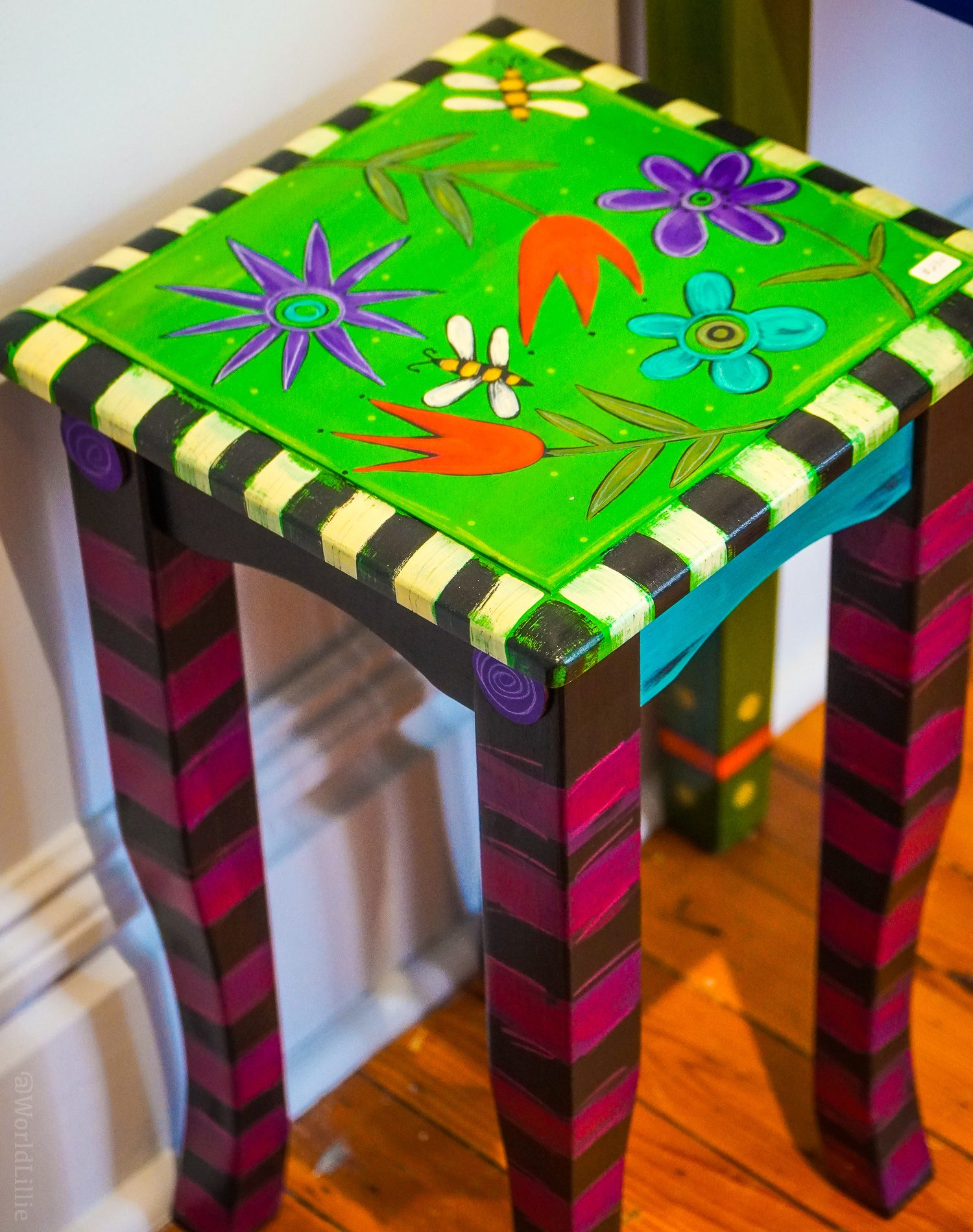 A jolly hand-painted side table.