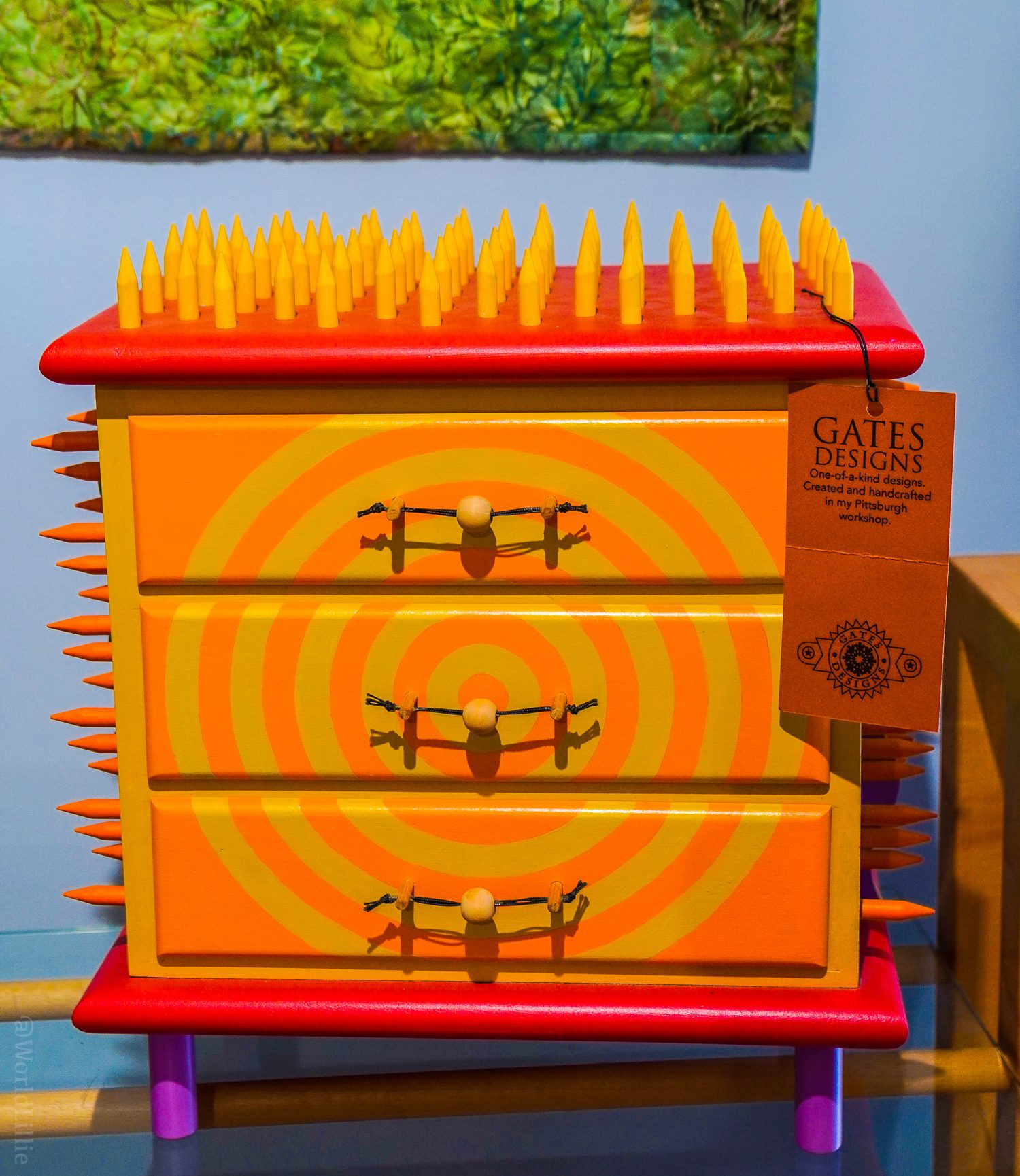 A spiky, neon set of little drawers.