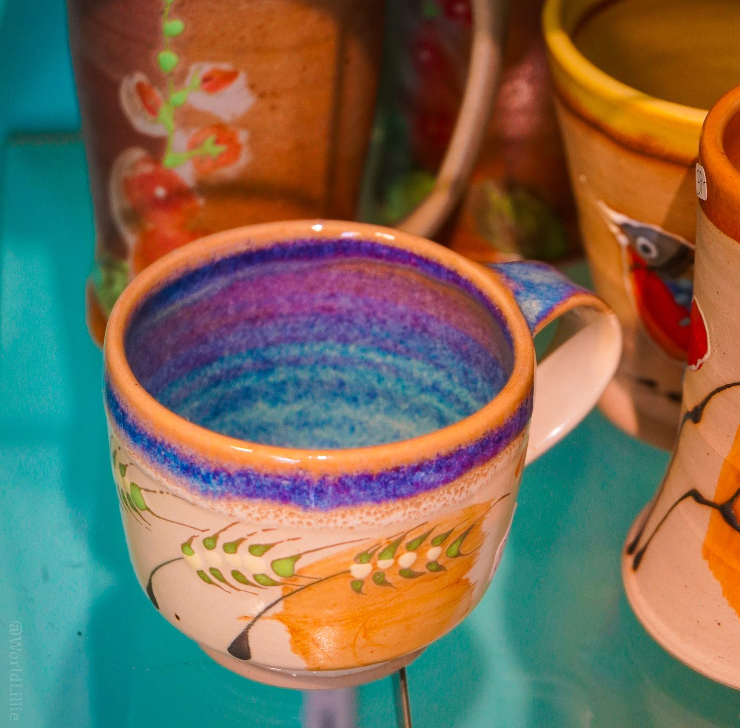 I love the teal and purple glaze inside this pottery.