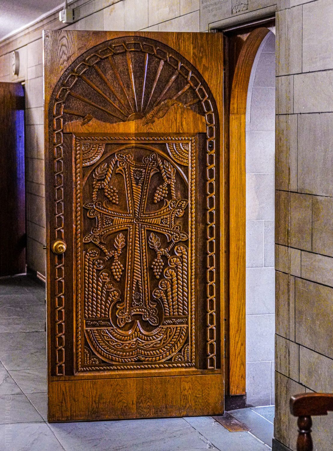 An ornate wooden door in the Armenian room.