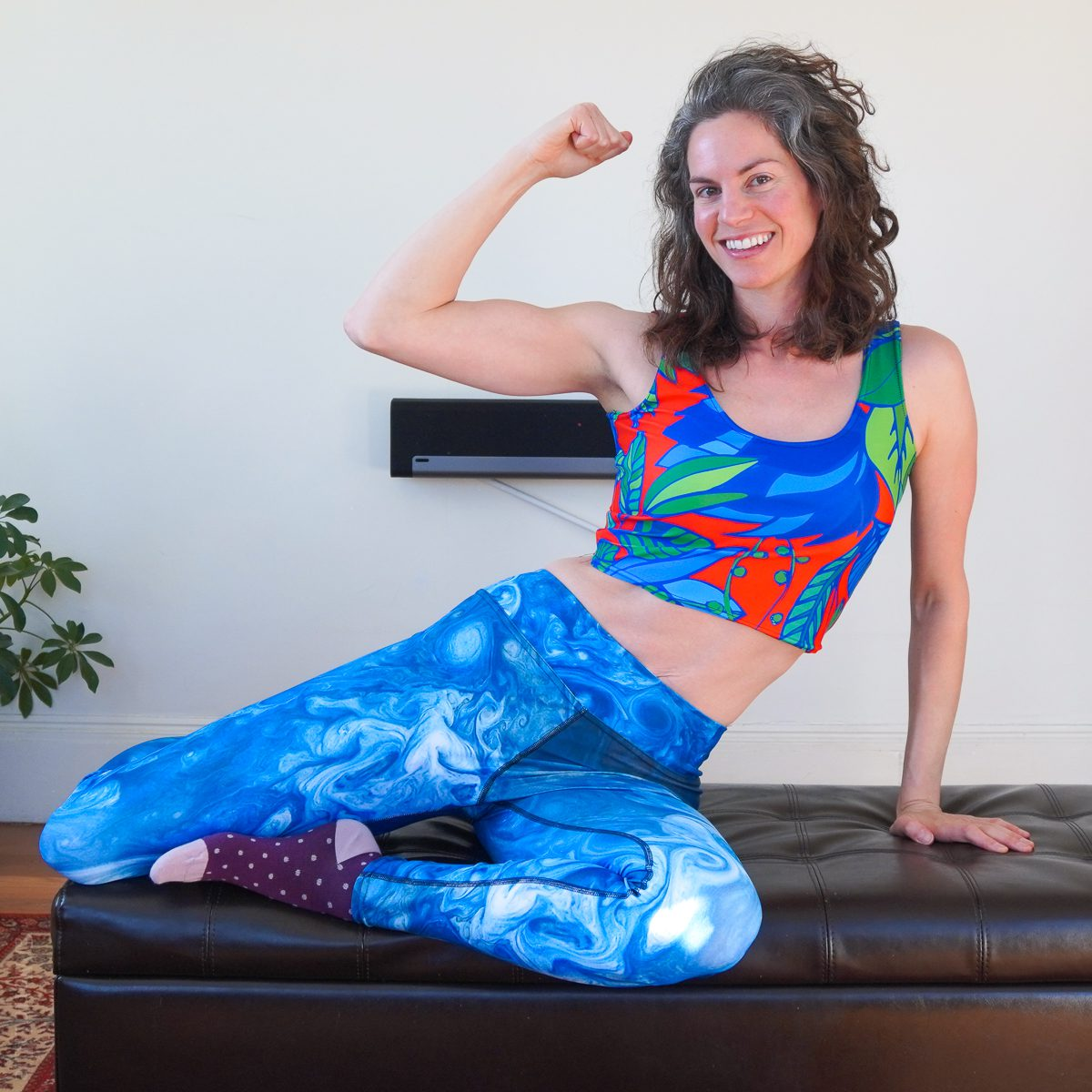 Flexing muscle, colorful leggings and workout clothes