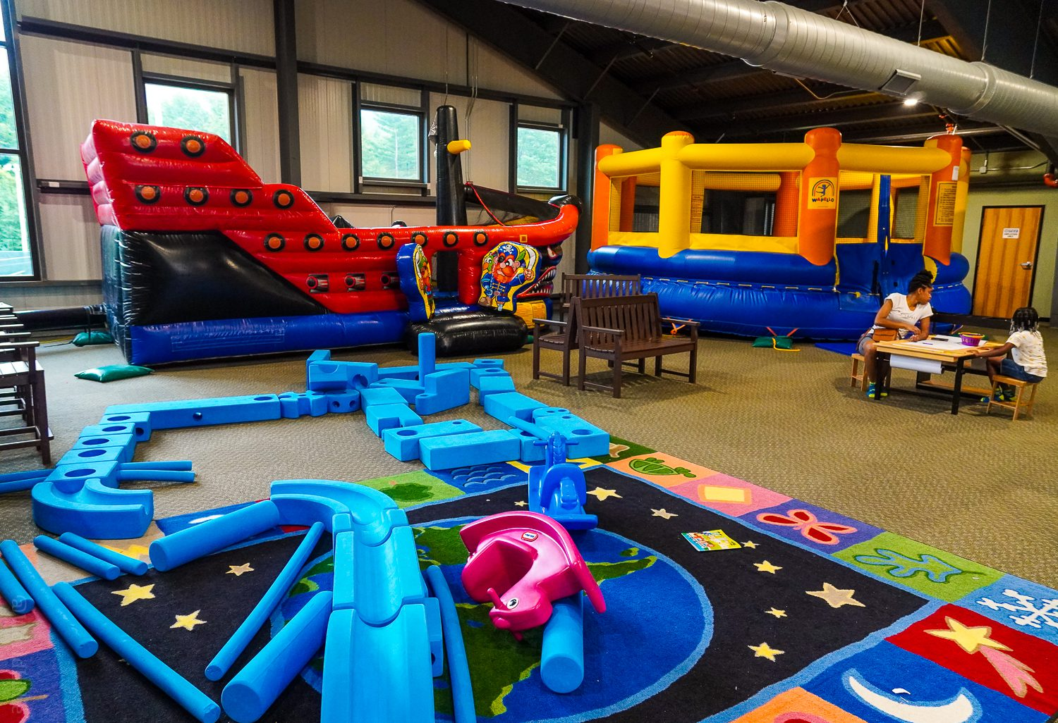 Bouncy houses and building foam at FunZone 2.0.