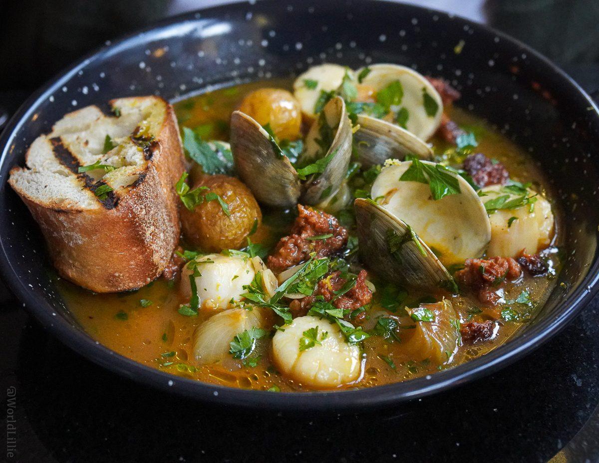 Scallop, clams, chorizo, cipollini onion, and garlic beer broth.