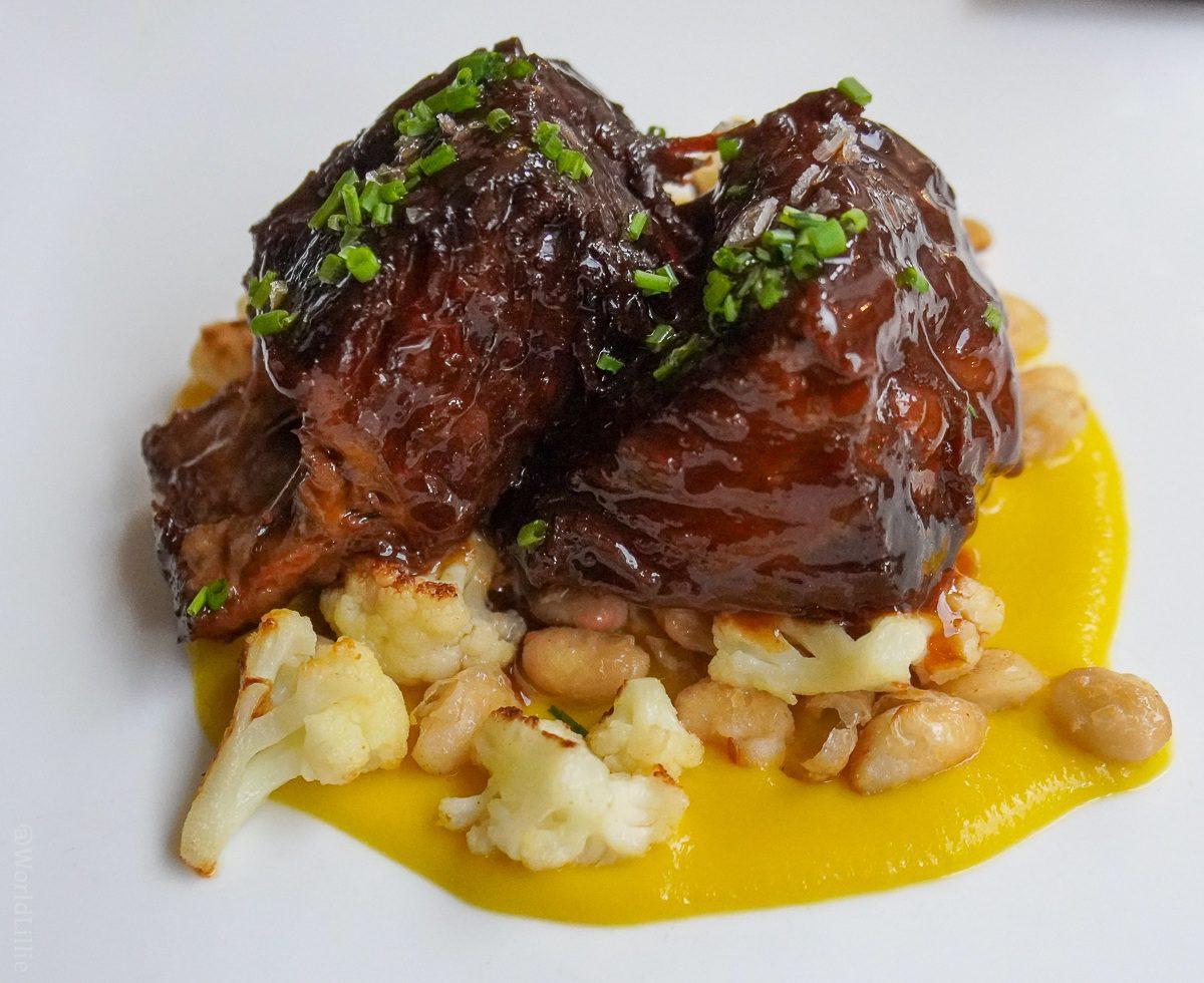 Beef short rib, garlic, saffron sauce, giant white bean, and cauliflower.