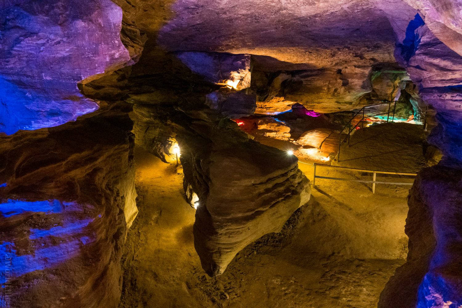 Looking down at a triangular rock formation in the caverns.